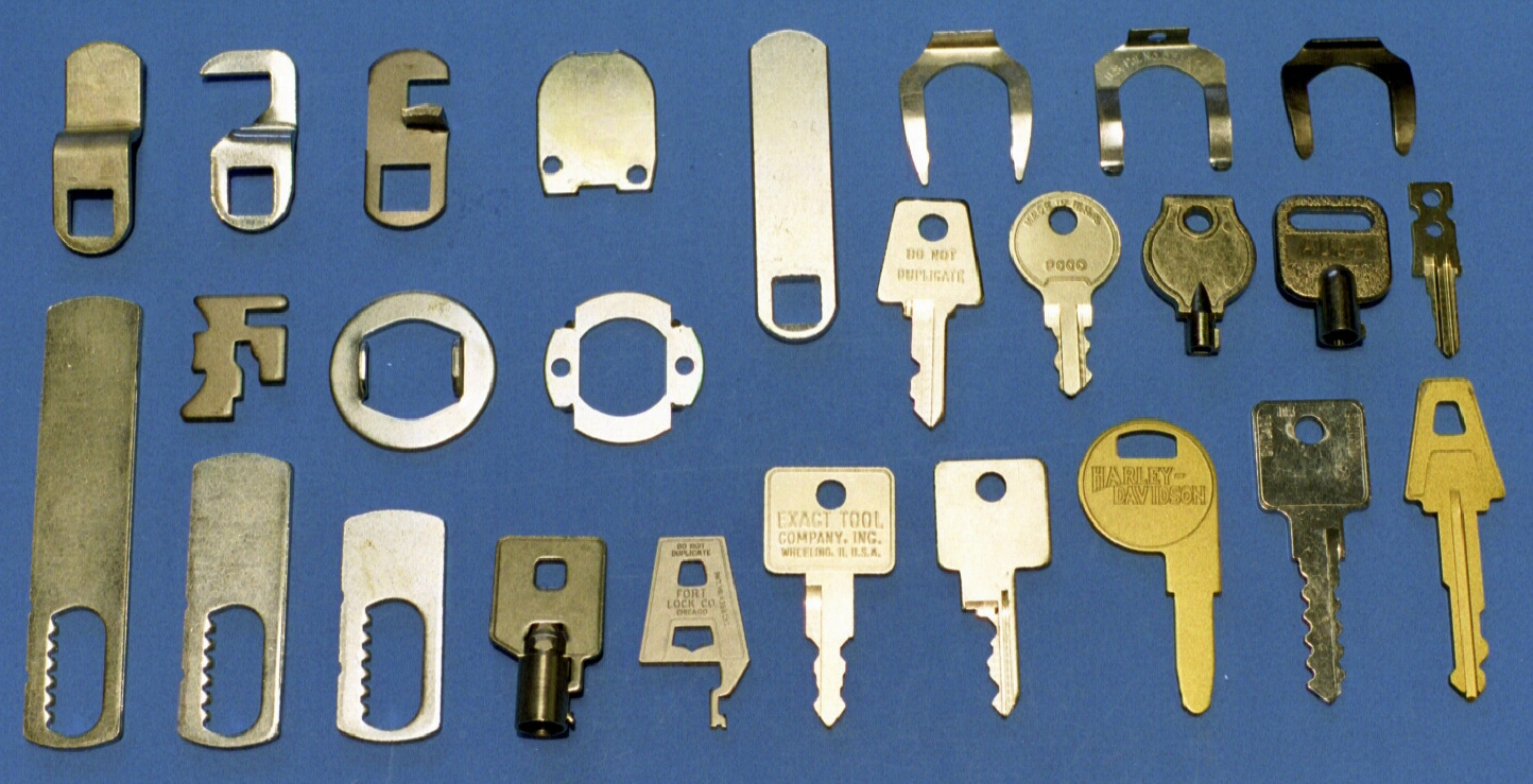 Metal stampings of lock components: Brass and steel keys, washers, cams, spring clips
